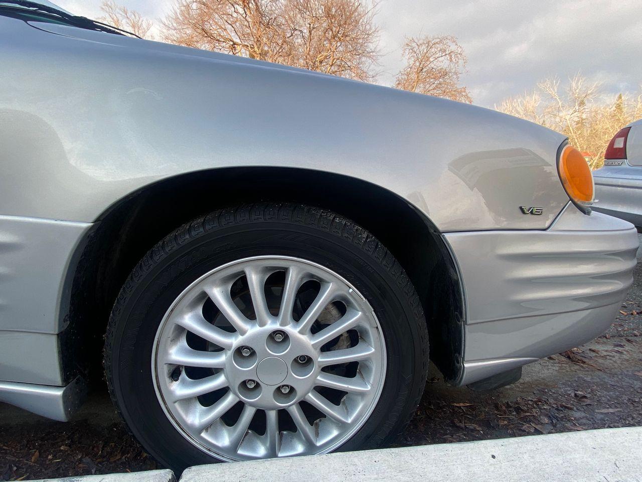2000 Pontiac Grand Am SE2 | San Jose, CA, Silvermist Metallic (Silver), Front Wheel